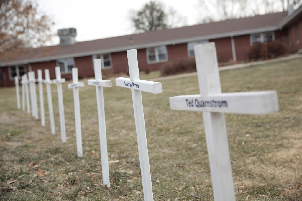 White crosses on the lawn of Good Samaritan Society nursing home Dec. 8, 2020, in Canton, S.D., commemorate residents who have died in recent weeks of...
