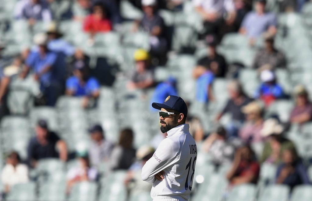 India's Virat Kohli stands with crossed arms near the end of their match against Australia on the third day of their cricket test match at the Adelaid...