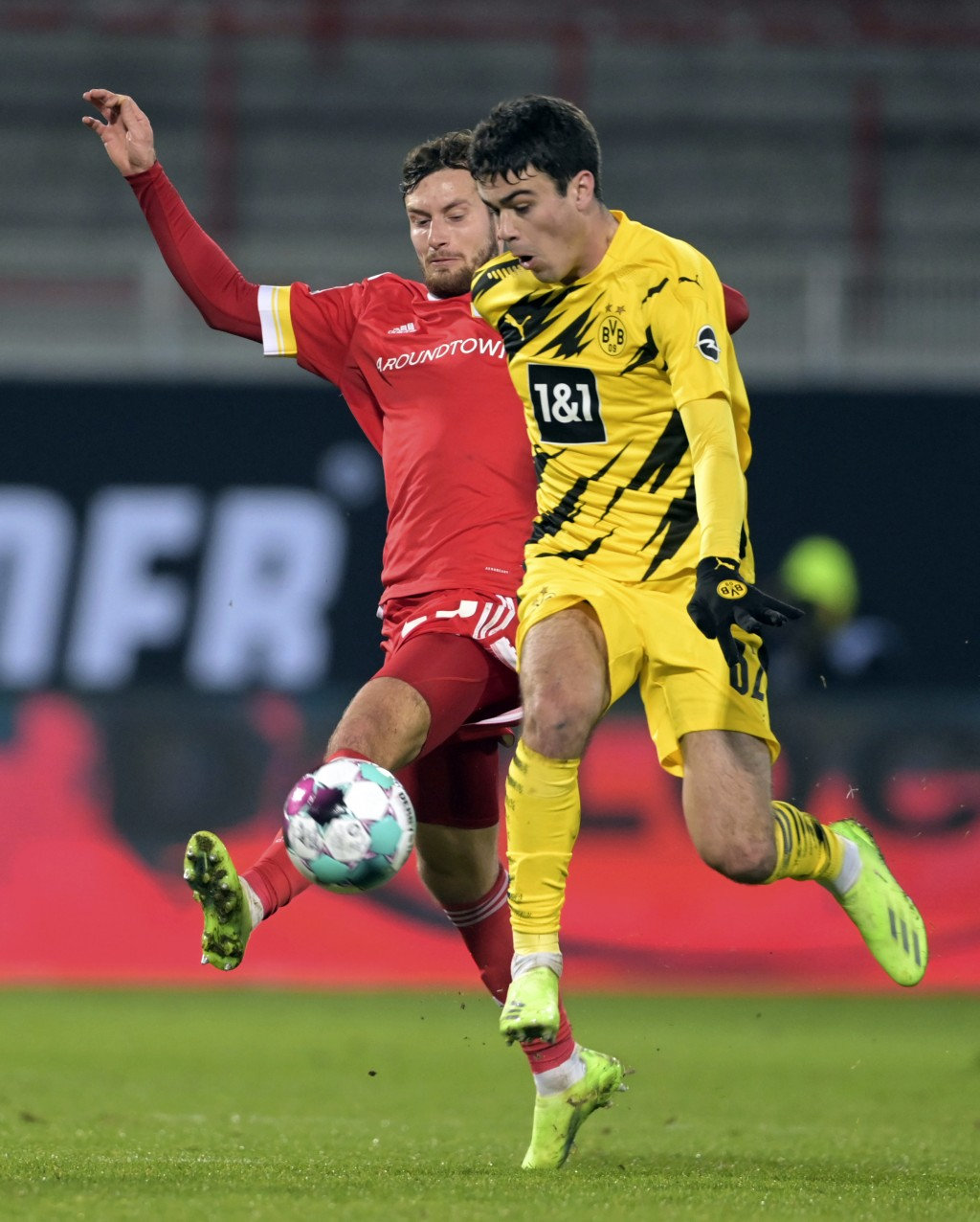 Union's Christopher Lenz, left, in action against Dortmund's Giovanni Reyna during the German Bundesliga soccer match between 1. FC Union Berlin and B...