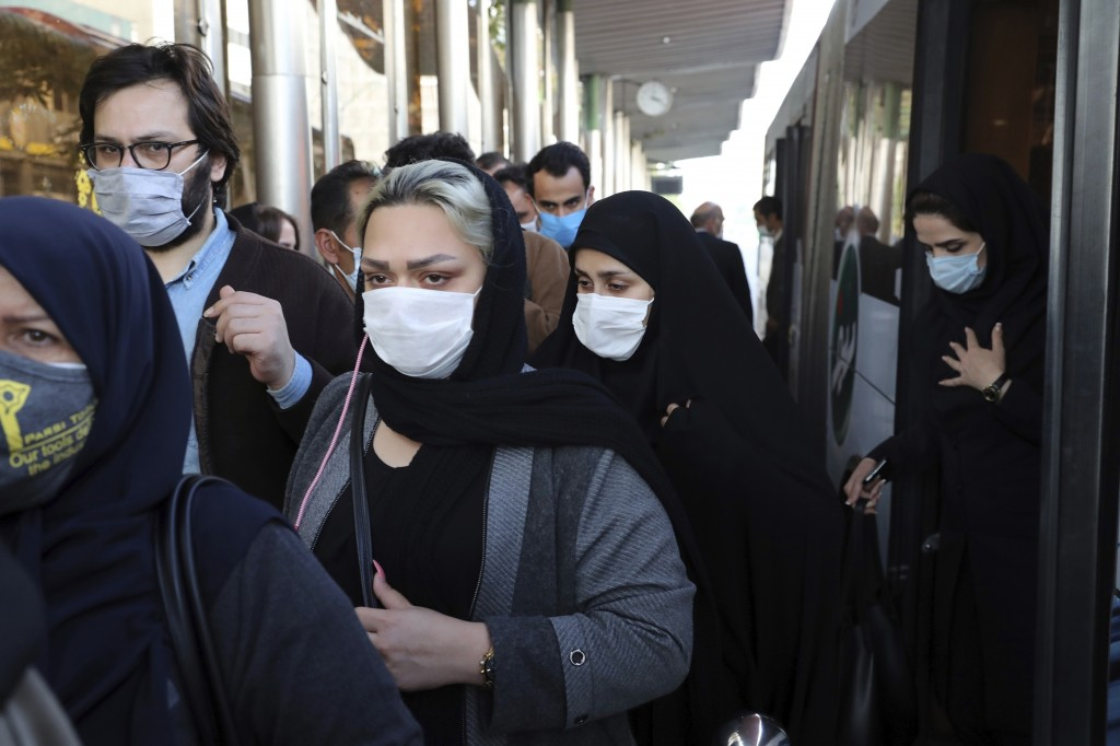 FILE - In this Oct. 11, 2020, file photo, people wear protective face masks to help prevent the spread of the coronavirus in downtown Tehran, Iran. Th...