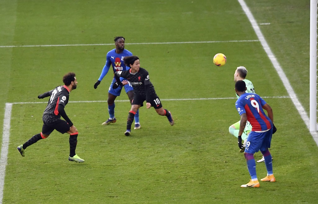 Liverpool's Mohamed Salah, left, scores his side's sixth goal during the English Premier League soccer match between Crystal Palace and Liverpool at S...
