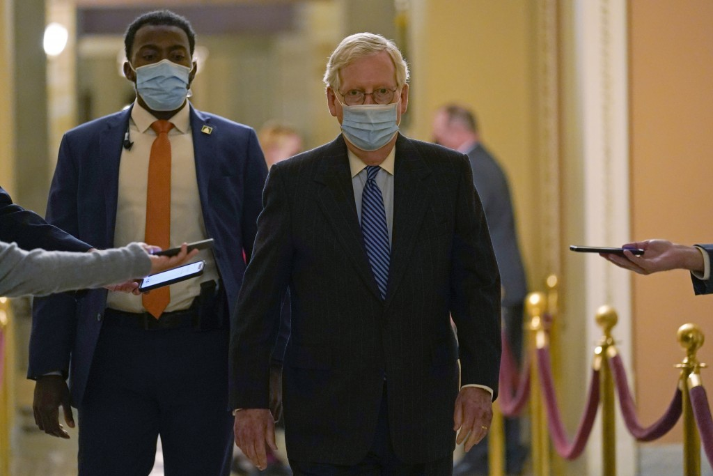 In this Dec. 15, 2029, photo, Senate Majority Leader Mitch McConnell of Ky., walks past reporters on Capitol Hill in Washington. (AP Photo/Susan Walsh...