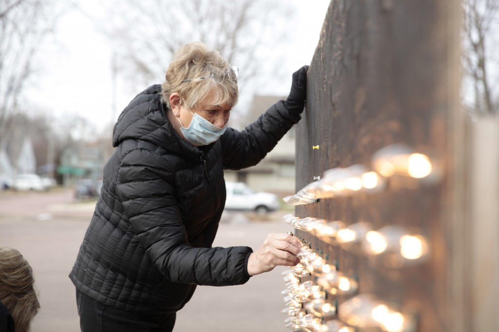 Dorothy Trumm, a member of Canton Lutheran Church, installs lights on a Nativity sign outside the church in Canton, S.D. on Dec. 8, 2020. Organizers o...