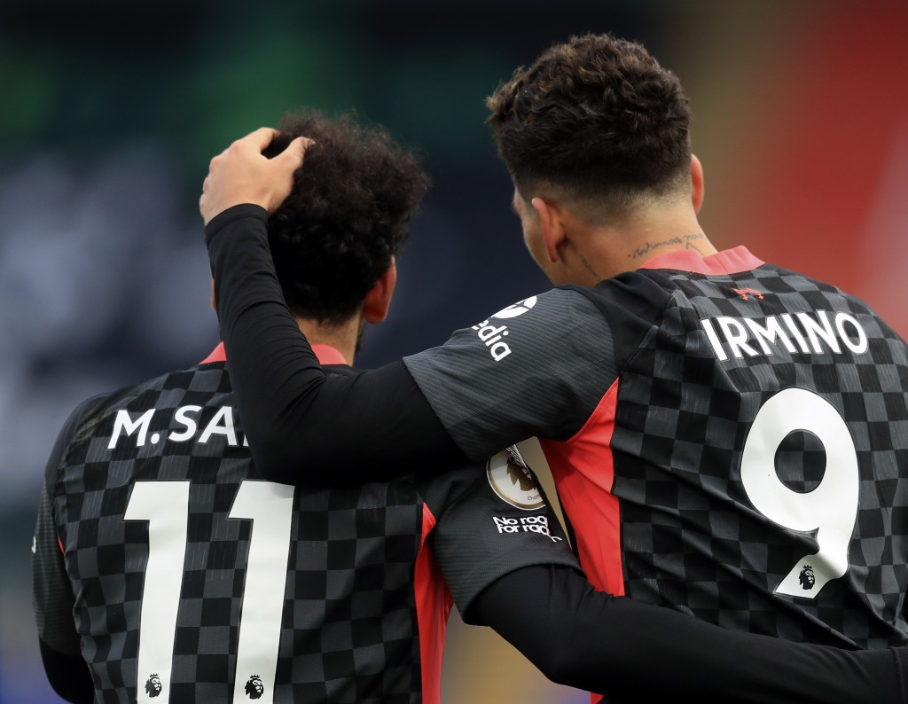 Liverpool's Roberto Firmino, right, celebrates with Liverpool's Mohamed Salah after scoring his side's fifth goal during the English Premier League so...