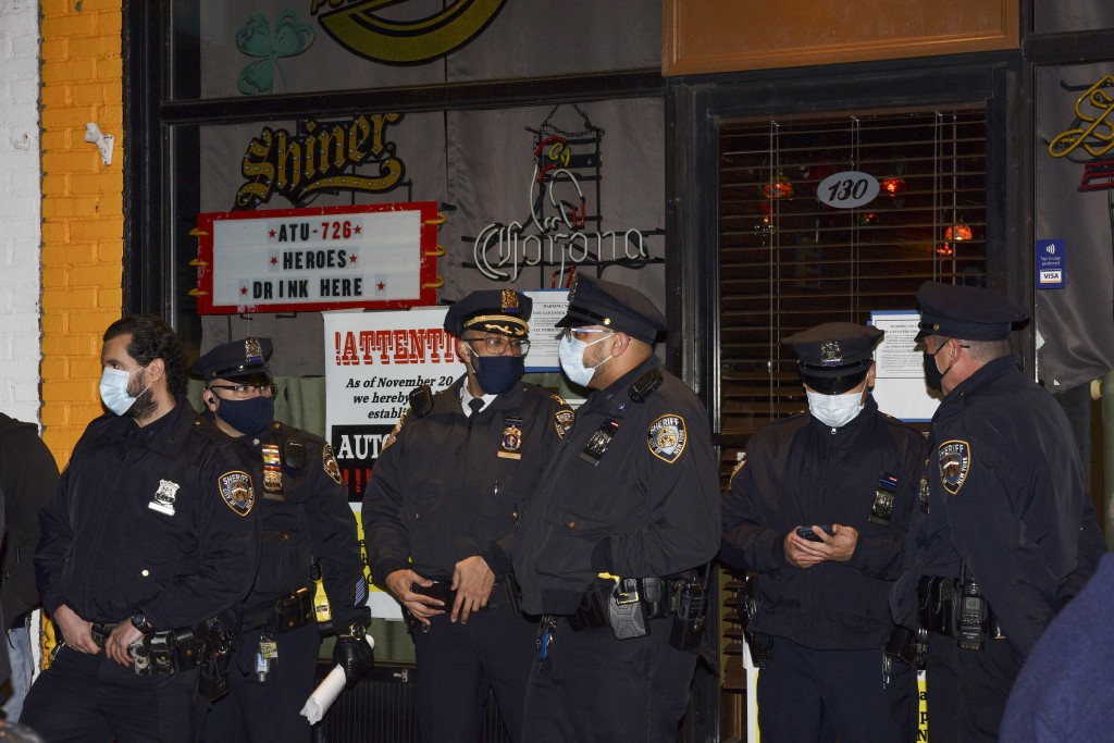 FILE —In this Dec. 1, 2020 file photo, New York City Sheriff's deputies stand outside Mac's Public House after co-owner Danny Presti was arrested, in ...
