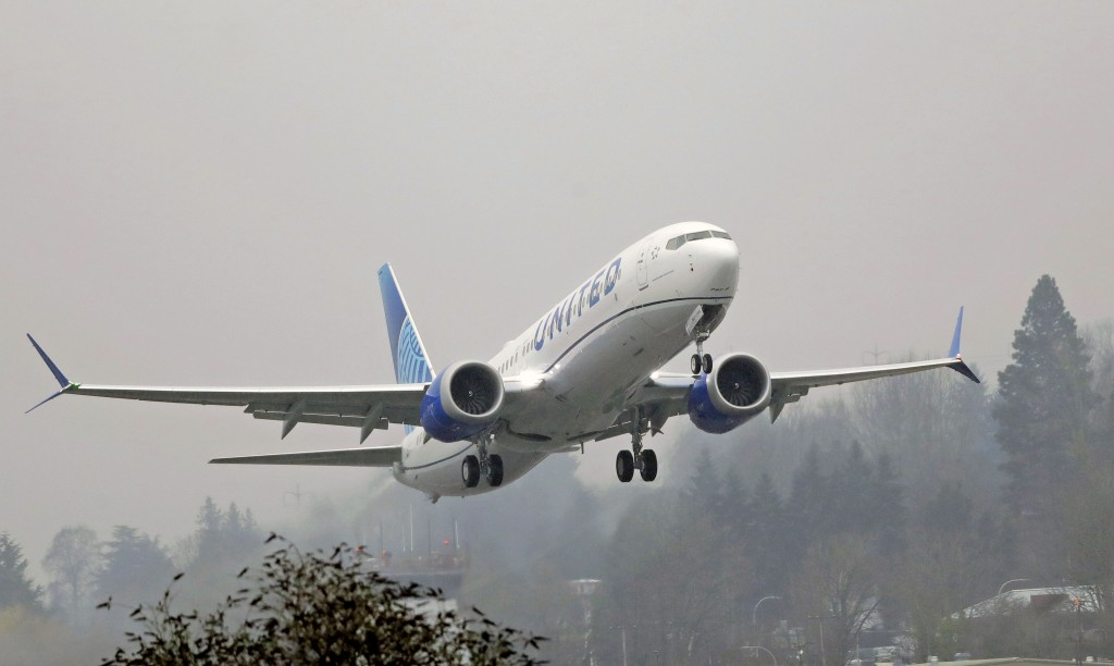 FILE - In this Wednesday, Dec. 11, 2019 file photo, a United Airlines Boeing 737 Max airplane takes off in the rain at Renton Municipal Airport in Ren...