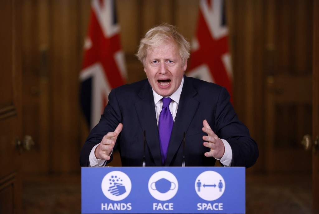 FILE - In this Wednesday Dec. 2, 2020 file photo, Prime Minister Boris Johnson speaks during a news conference on the ongoing situation with the coron...