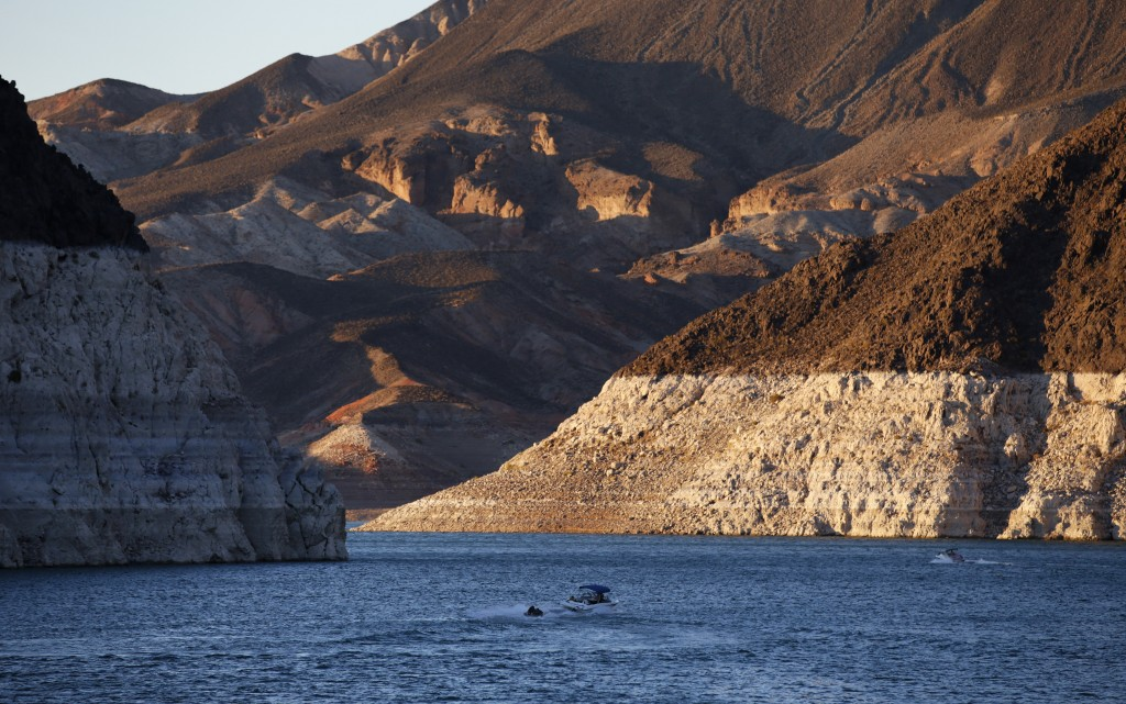 FILE - In this July 20, 2014 file photo, a bathtub ring of light minerals shows the high water line near Hoover Dam on Lake Mead at the Lake Mead Nati...