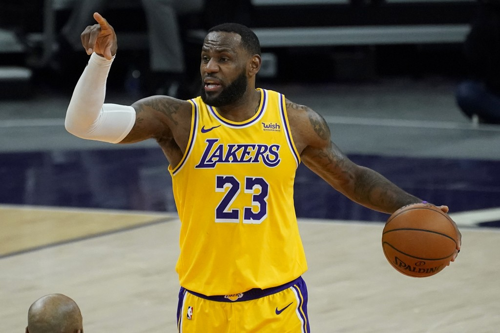 Los Angeles Lakers forward LeBron James (23) calls a play against the Phoenix Suns during the first half of a preseason NBA basketball game, Friday, D...