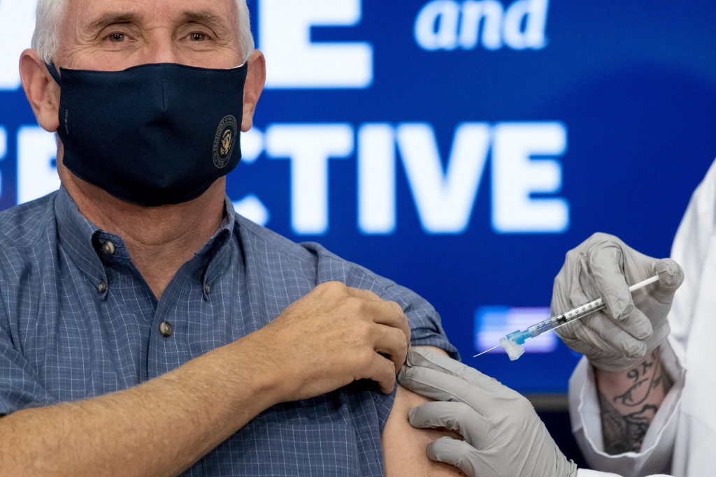 Vice President Mike Pence receives a Pfizer-BioNTech COVID-19 vaccine shot at the Eisenhower Executive Office Building on the White House complex, Fri...