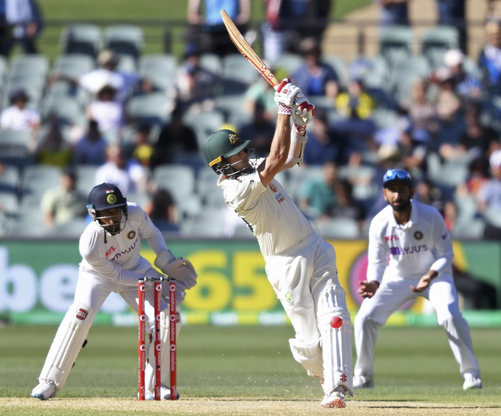 Australia's Joe Burns plays a shot against India on the third day of their cricket test match at the Adelaide Oval in Adelaide, Australia, Saturday, D...