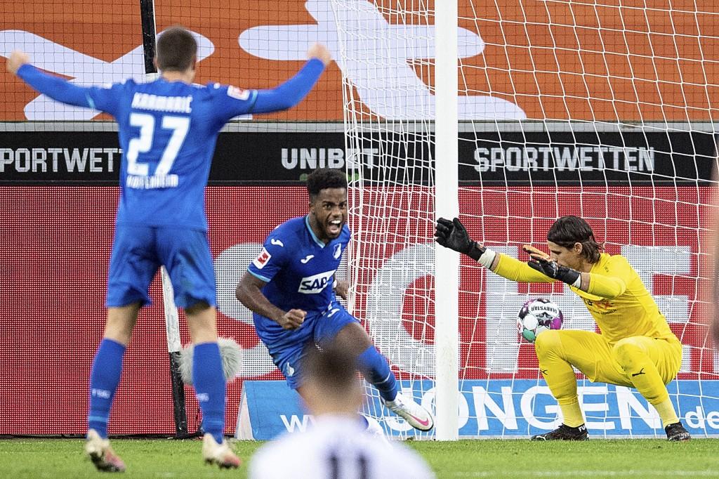 Hoffenheim's Andrej Kramaric, left, and goal scorer Ryan Sessegnon cheer after scoring past Moenchengladbach's goalkeeper Yann Sommer during their Ger...
