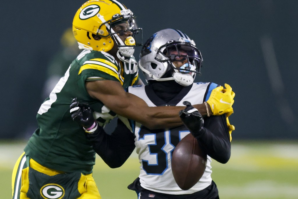 Carolina Panthers' Myles Hartsfield breaks up a pass intended for Green Bay Packers' Marquez Valdes-Scantling during the second half of an NFL footbal...