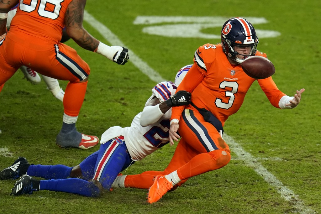 Denver Broncos quarterback Drew Lock fumbles the ball as he is hit by Buffalo Bills cornerback Tre'Davious White during the second half of an NFL foot...