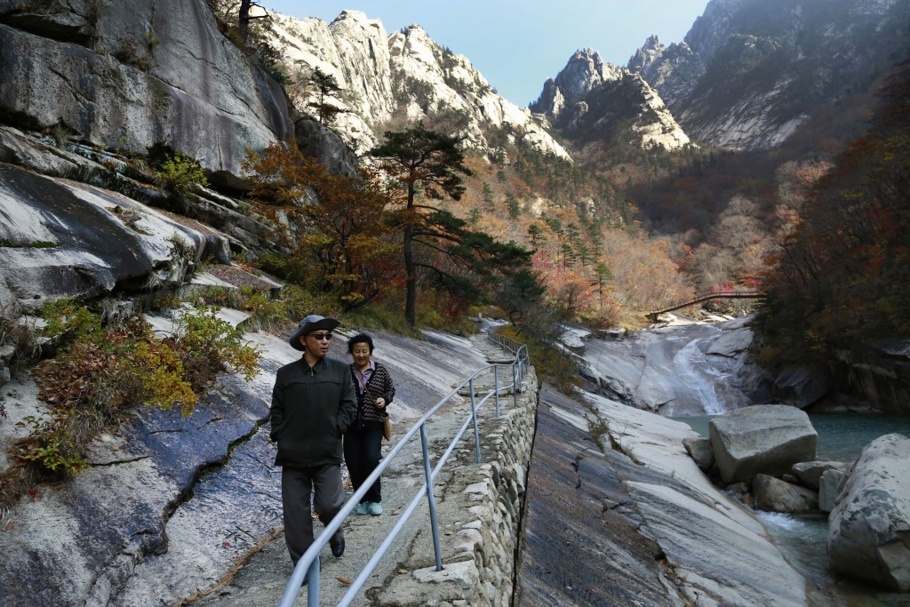FILE - In this Oct. 23, 2018, file photo, local tourists walk on the trail at Mount Kumgang, known as Diamond Mountain, in North Korea. A top North Ko...