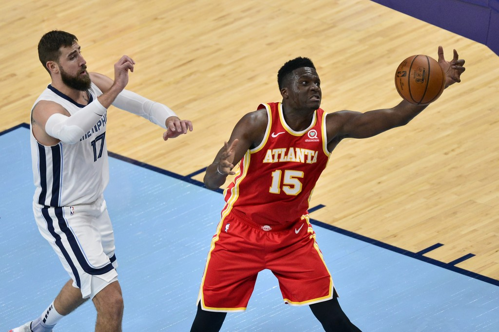 Atlanta Hawks center Clint Capela (15) reaches for the ball ahead of Memphis Grizzlies center Jonas Valanciunas (17) in the second half of an NBA pres...