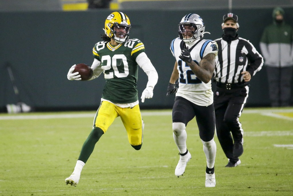 Green Bay Packers' Kevin King runs back a fumble in front of Carolina Panthers' D.J. Moore during the first half of an NFL football game Saturday, Dec...