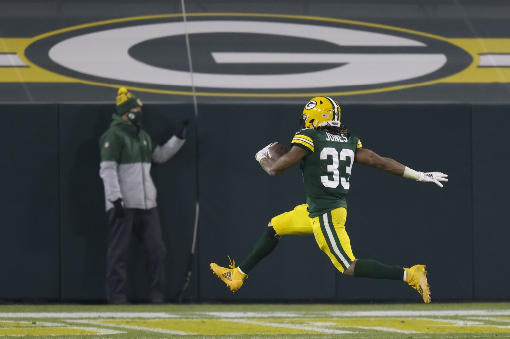 Green Bay Packers' Aaron Jones runs for a touchdown during the first half of an NFL football game against the Carolina Panthers Saturday, Dec. 19, 202...