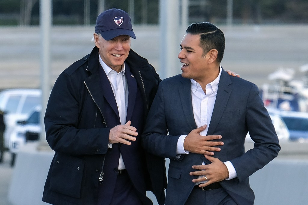 FILE - In this Jan. 9, 2020, file photo, Democratic presidential candidate Joe Biden, left, and Long Beach Mayor Robert Garcia arrive during a tour of...