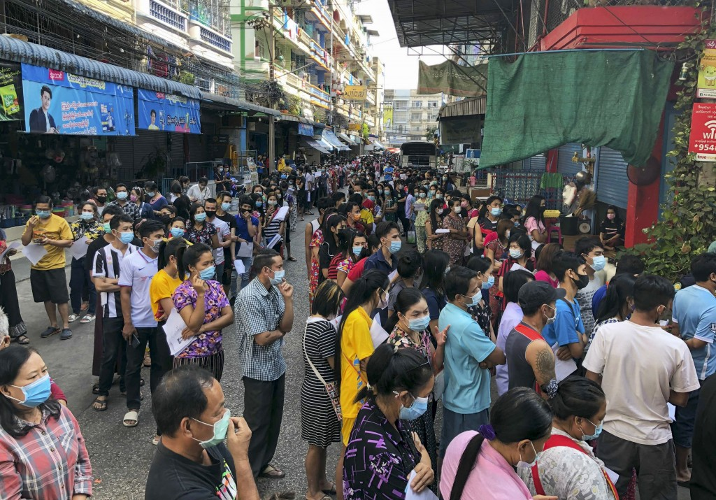 People stand in lines to get COVID-19 tests in Samut Sakhon, South of Bangkok, Thailand, Sunday, Dec. 20, 2020. Thailand reported more than 500 new co...