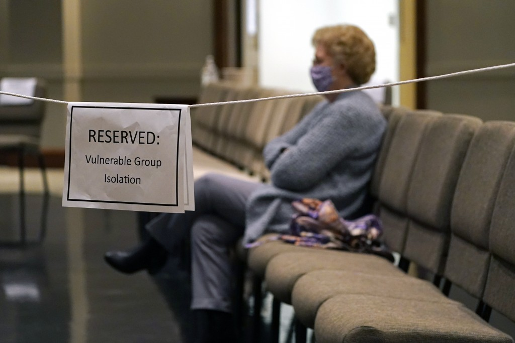 An older Highland Colony Baptist Church member sits in the reserved section for vulnerable adults in the Worship Center in Ridgeland, Miss., Nov. 29, ...