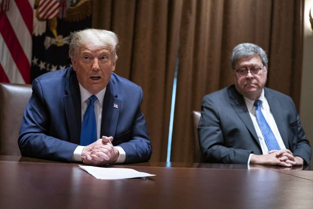 FILE - In this Sept. 23, 2020, file photo Attorney General William Barr listens as President Donald Trump speaks during a meeting with Republican stat...