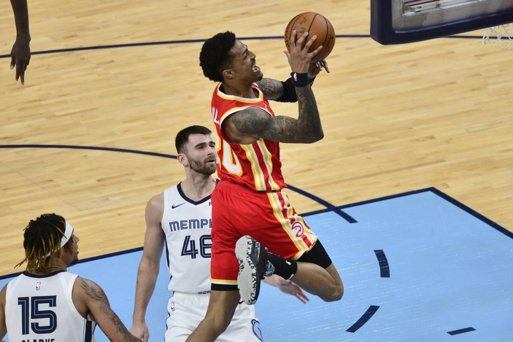 Atlanta Hawks forward John Collins (20) shoots against Memphis Grizzlies guard John Konchar (46) in the second half of an NBA preseason basketball gam...