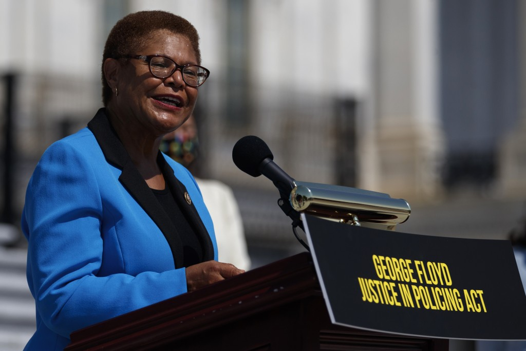 FILE - In this June 25, 2020, file photo Rep. Karen Bass, D-Calif., speaks during a news conference on the House East Front Steps on Capitol Hill in W...