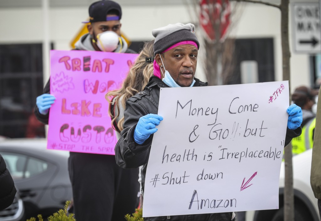 FILE—In this March 30, 2020 file photograph, workers from an Amazon fulfillment center in Staten Island, N.Y., protest conditions over fears COVID-19 ...