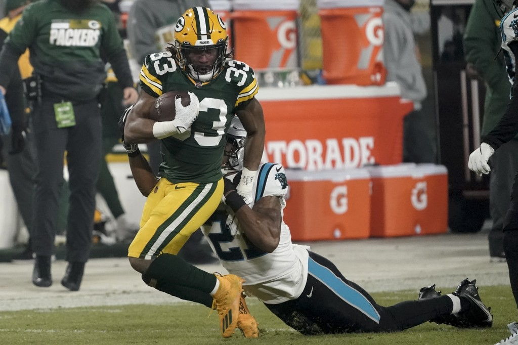 Carolina Panthers' Jeremy Chinn stops Green Bay Packers' Aaron Jones- on a long run during the first half of an NFL football game Saturday, Dec. 19, 2...