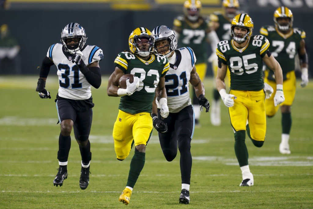 Green Bay Packers' Aaron Jones runs during the first half of an NFL football game against the Carolina Panthers Saturday, Dec. 19, 2020, in Green Bay,...