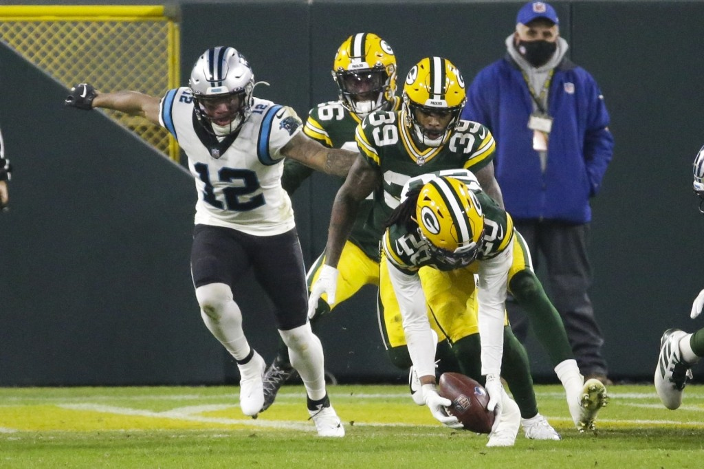 Green Bay Packers' Kevin King recovers a fumble in front of Carolina Panthers' D.J. Moore during the first half of an NFL football game Saturday, Dec....
