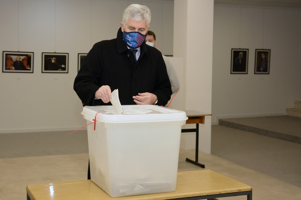 Dragan Covic of the Croatian Democratic Union (HDZ) casts his ballot for the local elections at a polling station in Mostar, Bosnia, Sunday, Dec. 20, ...