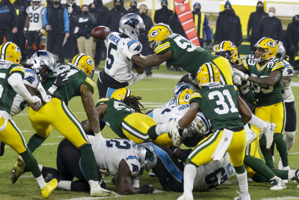 Green Bay Packers' Krys Barnes knocks the ball away from Carolina Panthers' Teddy Bridgewater at the goal line during the first half of an NFL footbal...