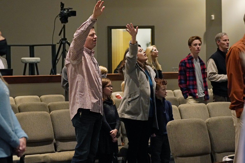 Congregants sing along with the choir at Highland Colony Baptist Church in Ridgeland, Miss., Nov. 29, 2020. The church practices covid protocols by al...