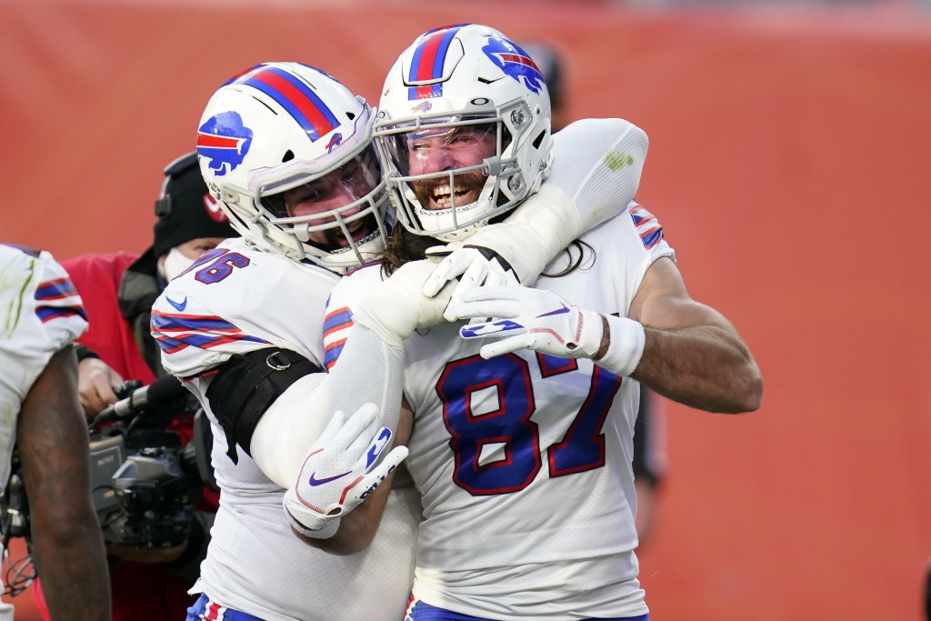 Buffalo Bills wide receiver Jake Kumerow, right, celebrates with teammate center Jon Feliciano after scoring a touchdown during the first half of an N...