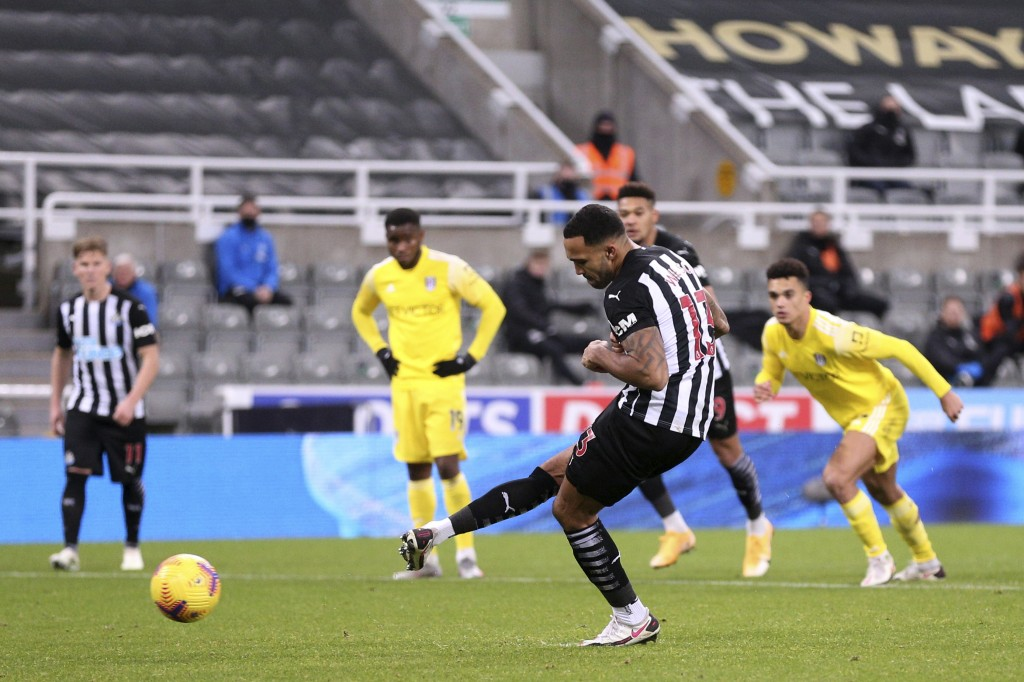 Newcastle's Callum Wilson scores his side's first goal from a penalty kick during an English Premier League soccer match between Newcastle United and ...