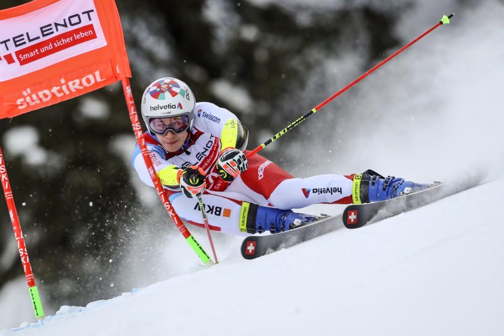 Switzerland's Marco Odermatt speeds down the course during an alpine ski, men's World Cup giant slalom in Alta Badia, Italy, Sunday, Dec.20, 2020. (AP...
