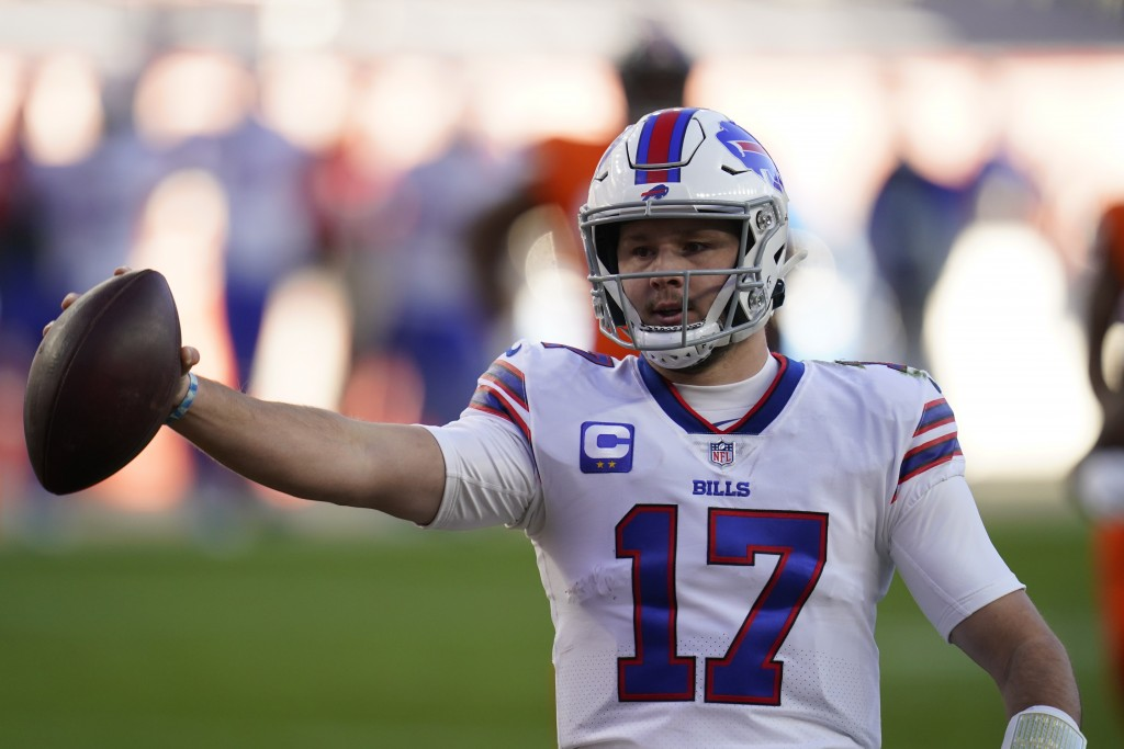 Buffalo Bills quarterback Josh Allen celebrates after scoring a touchdown during the first half of an NFL football game against the Denver Broncos, Sa...