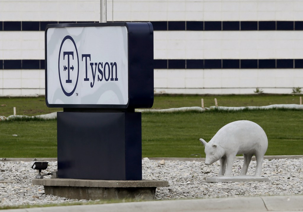 FILE—In this May 1, 2020, file photo, a sign sits in front of the Tyson Foods plant in Waterloo, Iowa. The coronavirus devastated the nation's meatpac...