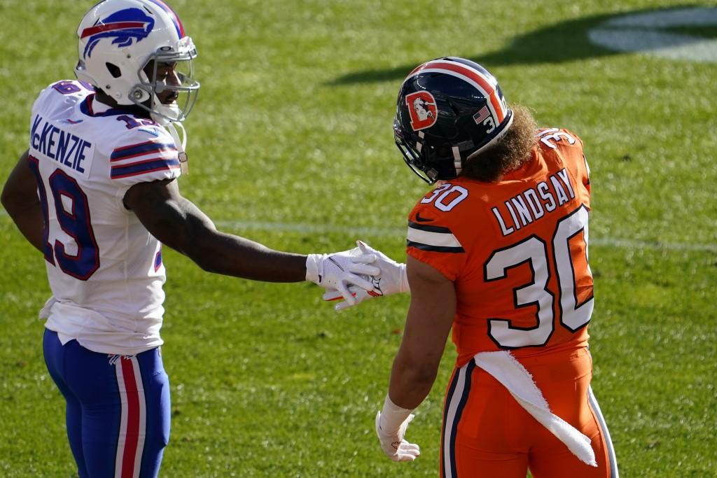 Buffalo Bills wide receiver Isaiah McKenzie, left, greets Denver Broncos running back Phillip Lindsay before an NFL football game Saturday, Dec. 19, 2...