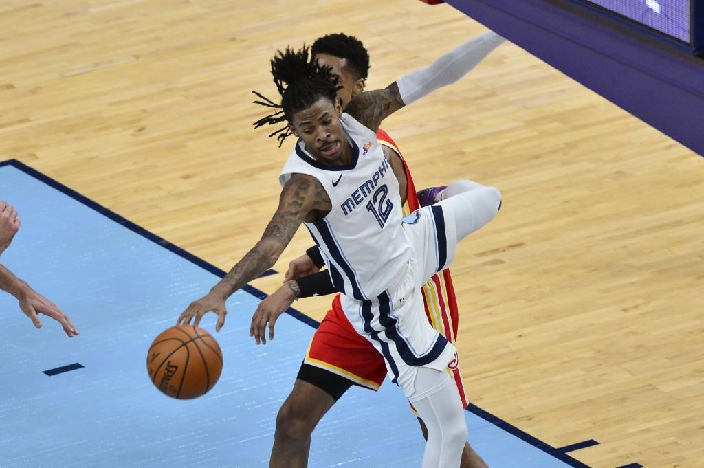 Memphis Grizzlies guard Ja Morant (12) jumps for the ball in the second half of an NBA preseason basketball game against the Atlanta Hawks, Saturday, ...