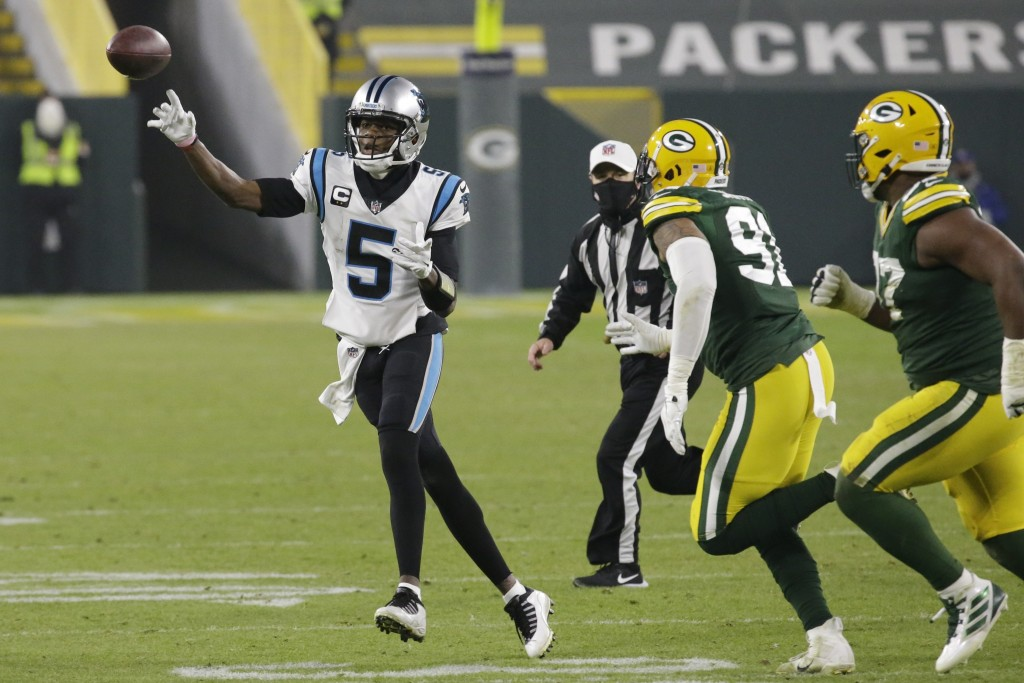 Carolina Panthers' Teddy Bridgewater throws a pass during the second half of an NFL football game against the Green Bay Packers Saturday, Dec. 19, 202...