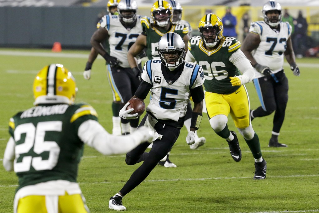 Carolina Panthers' Teddy Bridgewater runs for a touchdown during the second half of an NFL football game against the Green Bay Packers Saturday, Dec. ...