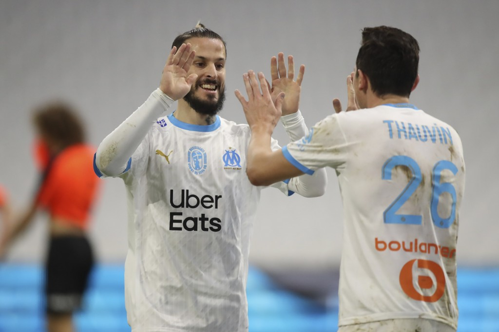 Marseille's Florian Thauvin, right, celebrates his goal with his teammate Dario Benedetto against Rennes during the French League One soccer match bet...