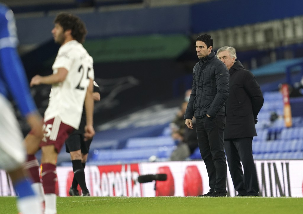 Everton's manager Carlo Ancelotti, right, and Arsenal's manager Mikel Arteta follow the game during the English Premier League soccer match between Ev...