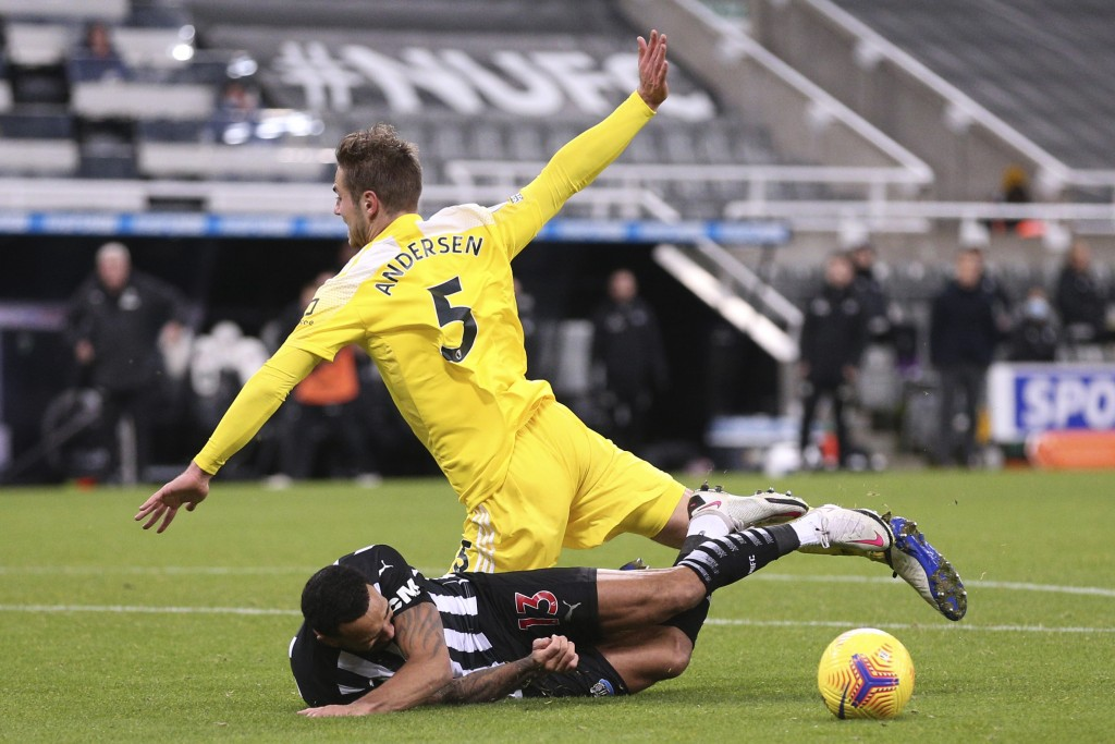 Fulham's Joachim Andersen, top and Newcastle's Callum Wilson clash during an English Premier League soccer match between Newcastle United and Fulham a...