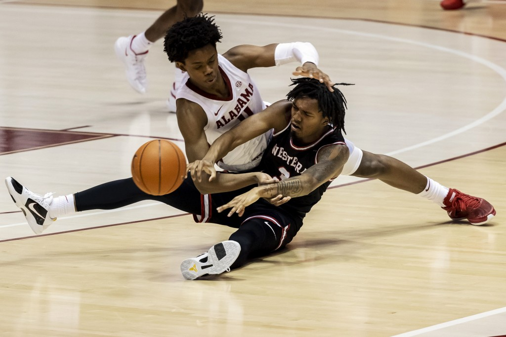Alabama guard Joshua Primo (11) and Western Kentucky guard Jordan Rawls (3) battle for a loose ball during the second half of an NCAA college basketba...
