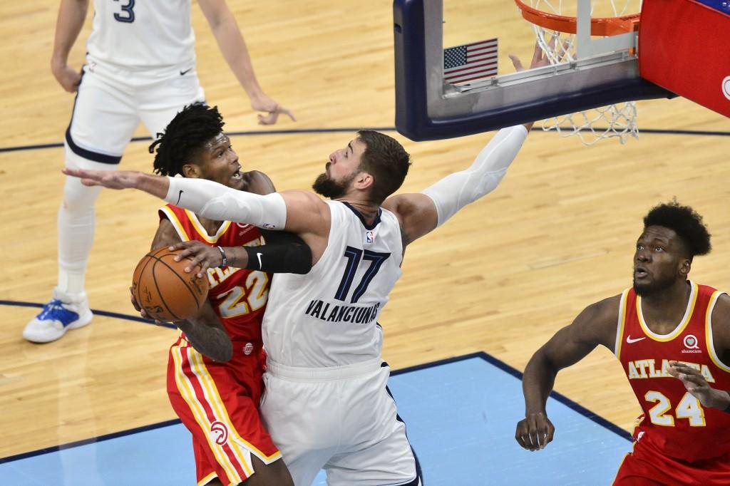 Atlanta Hawks forward Cam Reddish (22) drives against Memphis Grizzlies center Jonas Valanciunas (17) in the second half of an NBA preseason basketbal...