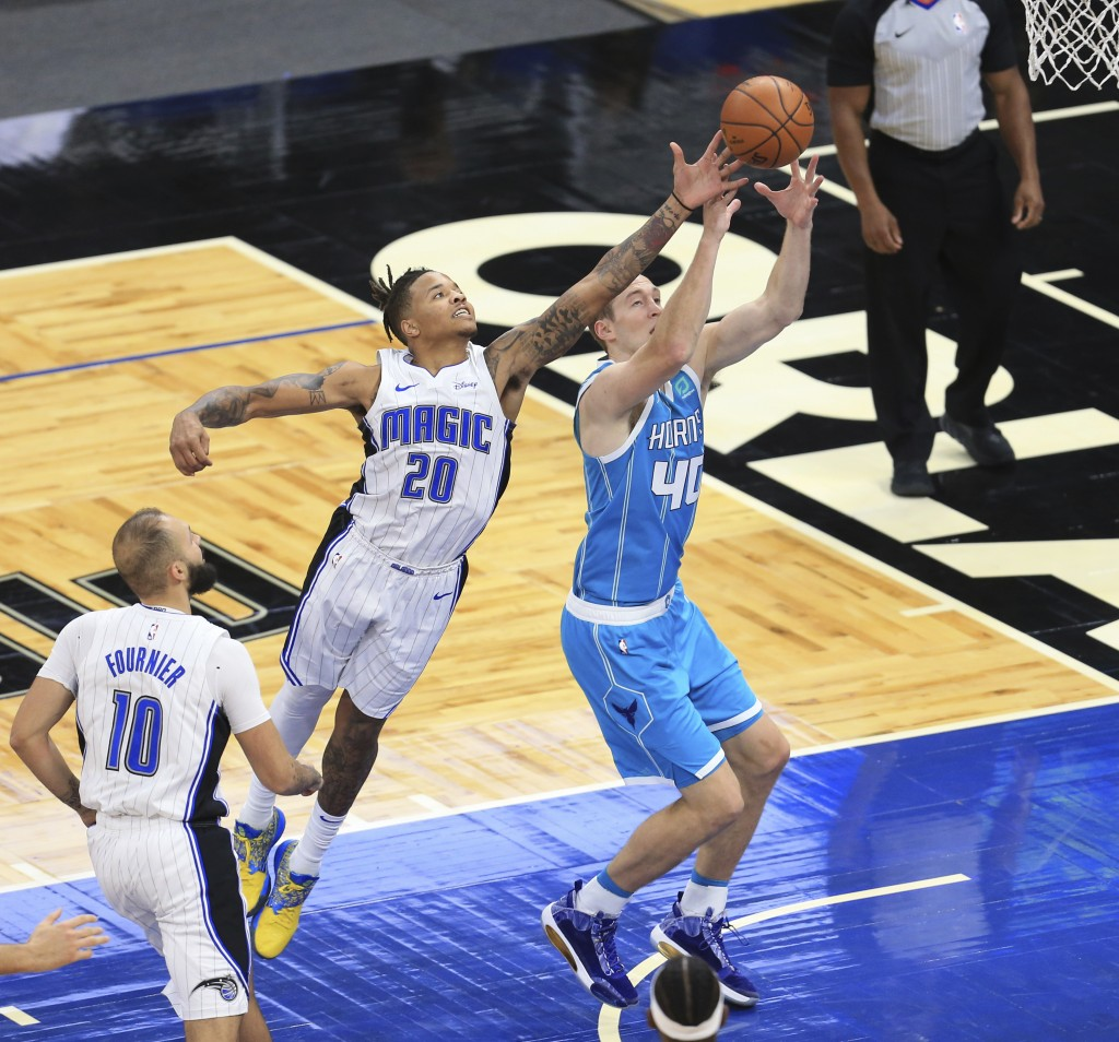 Orlando Magic guard Markelle Fultz (20) tips the ball away from Charlotte Hornets forward Cody Zeller (40) during the first half of an NBA basketball ...